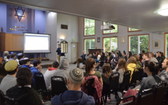 Agenda Committee Chair Avi Kintzer leads a Town Hall during the 2019-2020 school year.